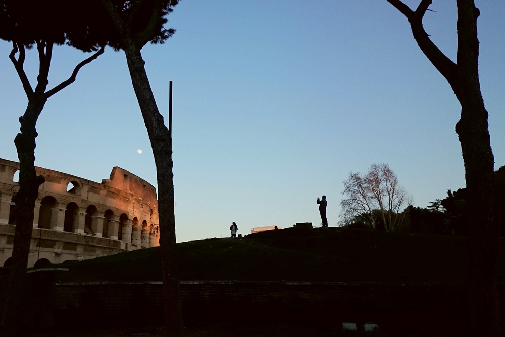 Taking pictures of the Colosseum at sunset