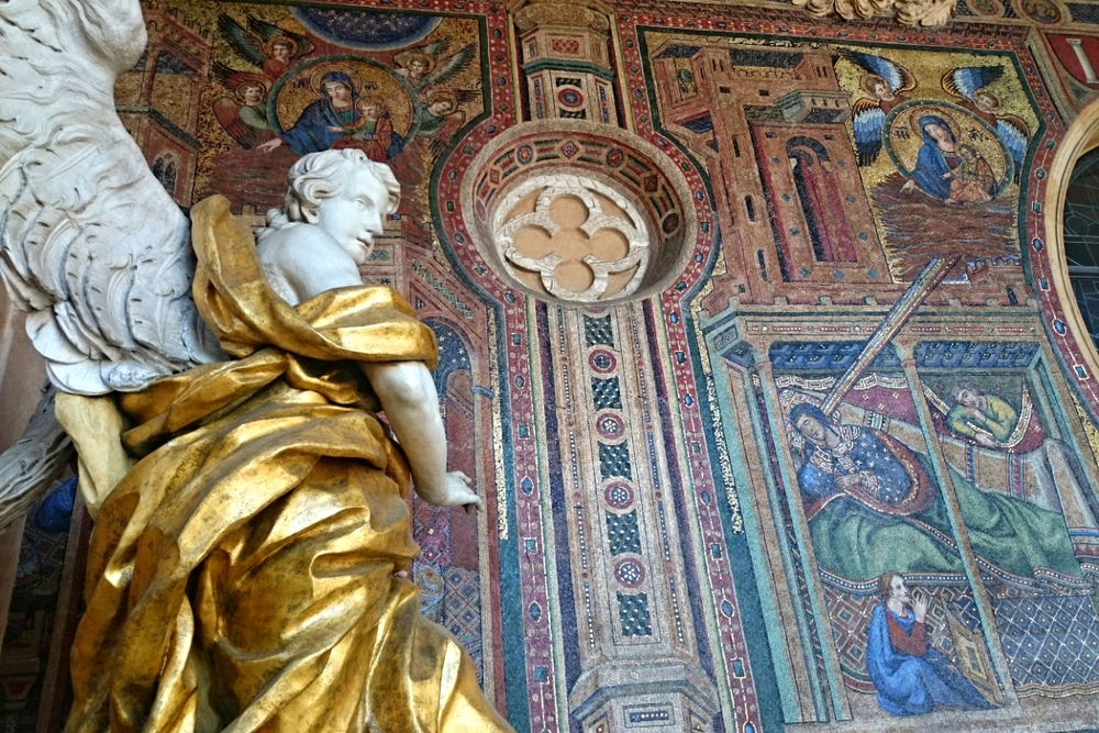 Close up of the mosaics of the facade with a giant guarding angel