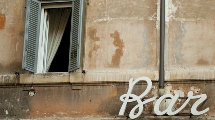 the sign of bar san calisto in trastevere, rome