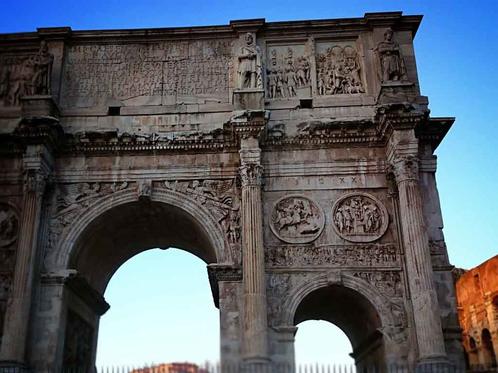 Arch of Constantine just at the exit of the Roman Forum