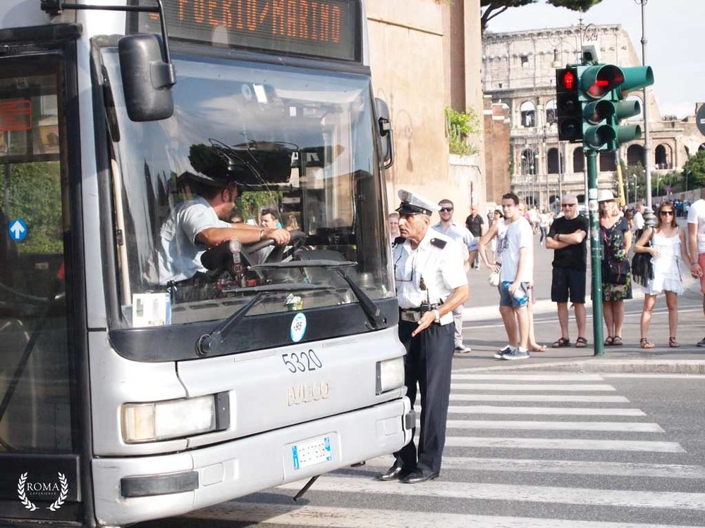 A bus driver and Vigile Urbano having an argument in Rome in the middle of the street by the Colosseum