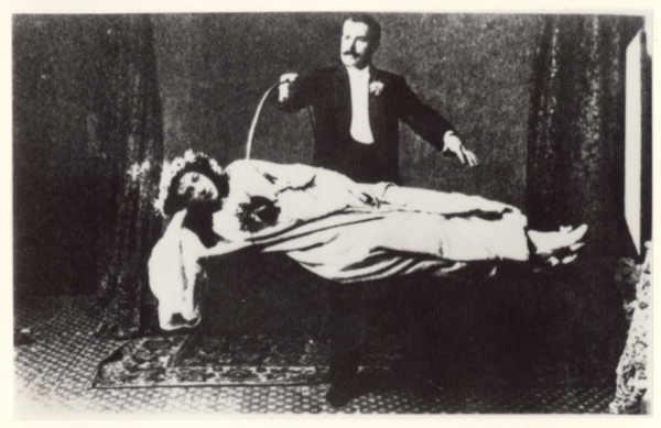 David Devant levitating a woman.