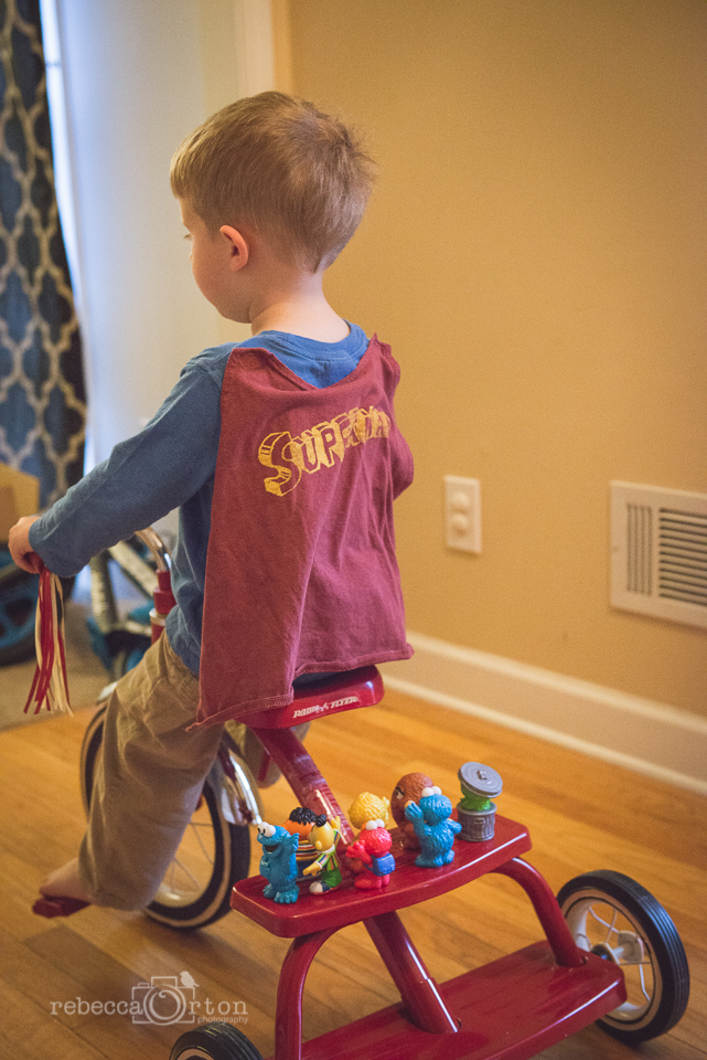 "2.16.2015 Yes, Jack rides his tricycle in the house:) But the best part is when he takes toys for a ride. On this day it was his ""Elmo Friends."""