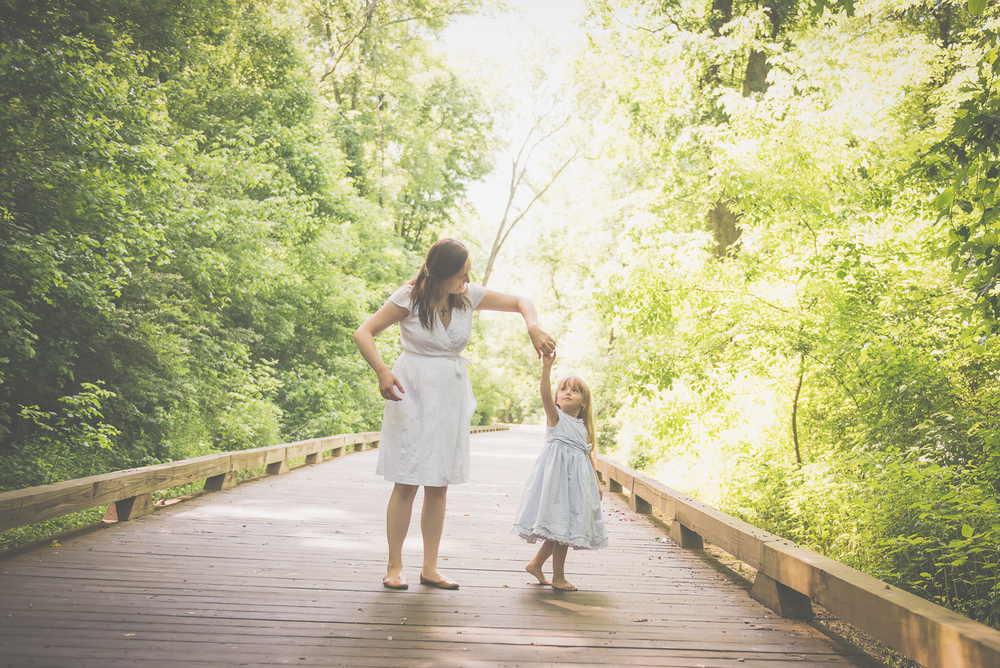 mom and daughter twirling