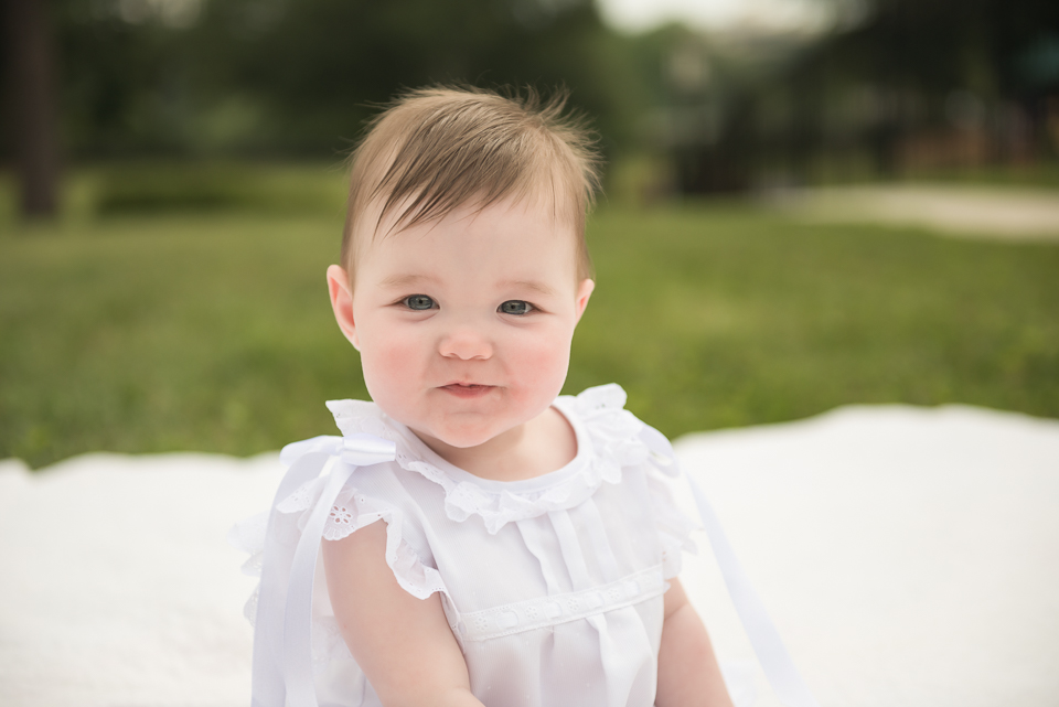 baby girl in baptism gown
