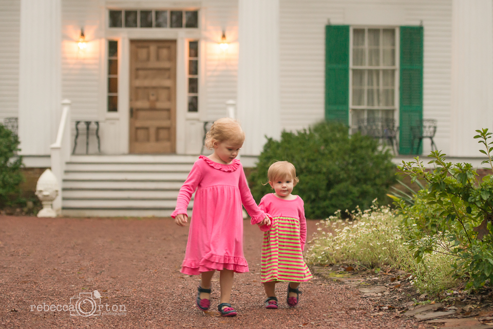 sisters holding hands in pink