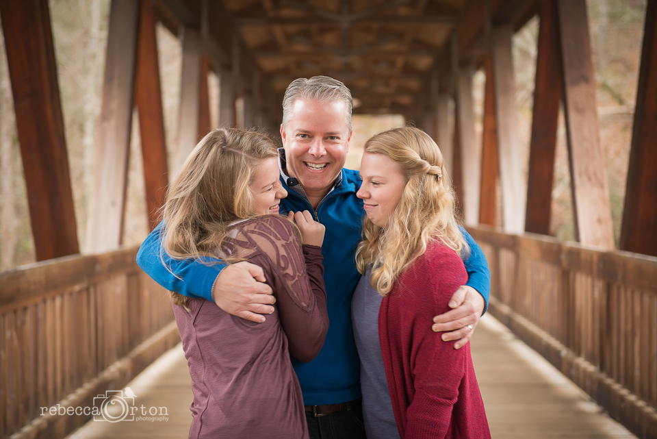 father and teen daughters