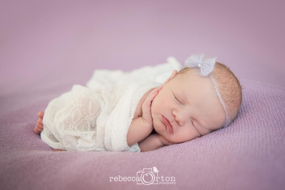 newborn girl purple bow