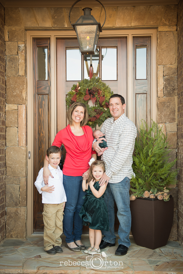 christmas family of 5 smiling at camera front porch