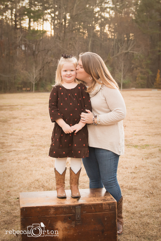 mom and daughter moment kiss