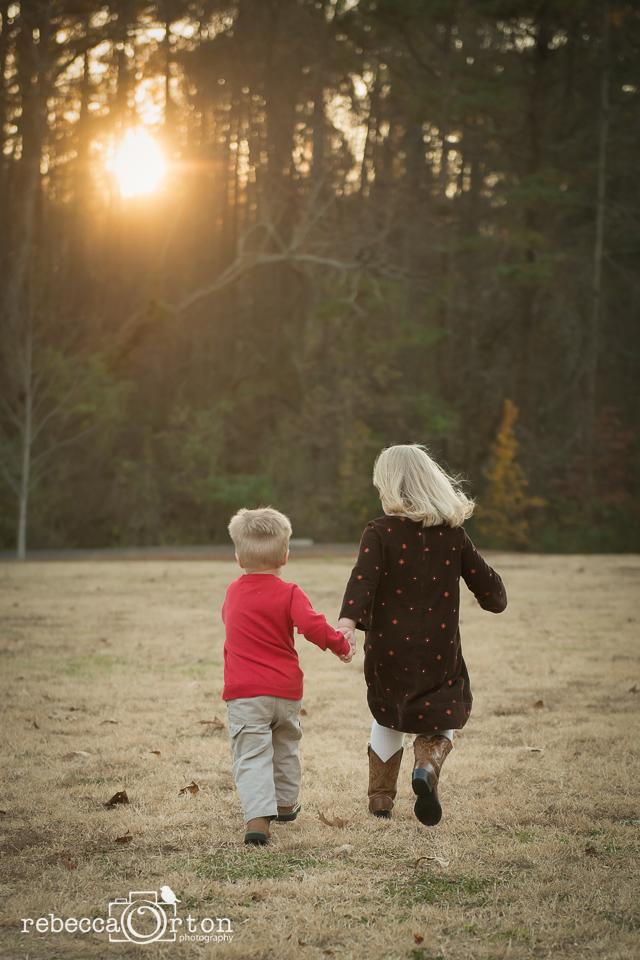 siblings holding hands