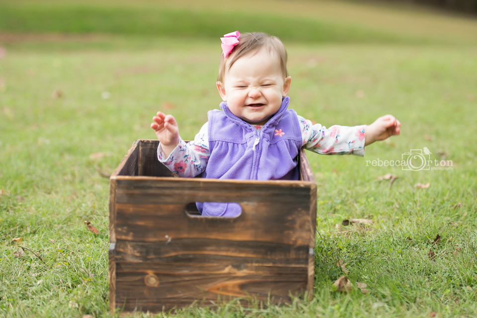 grinning baby girl in purple