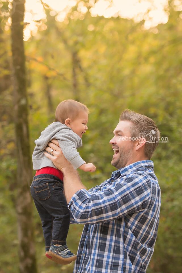 dad smiling at baby boy