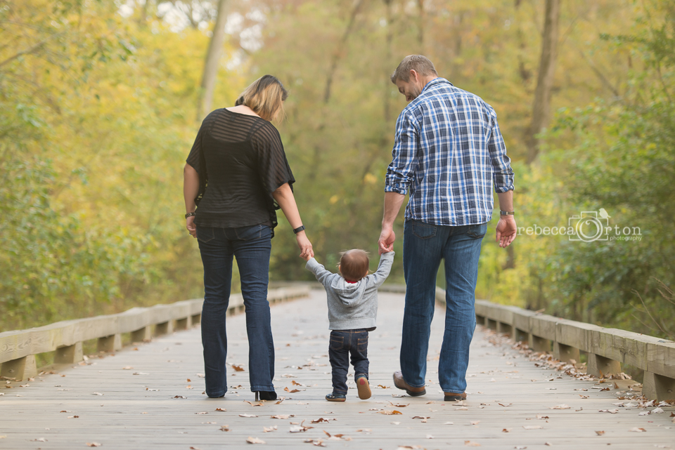 family of 3 walking