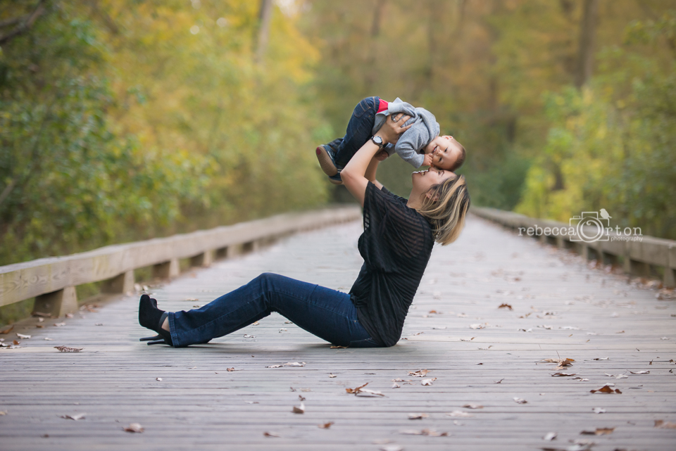 mom lifting baby on big creek greenway