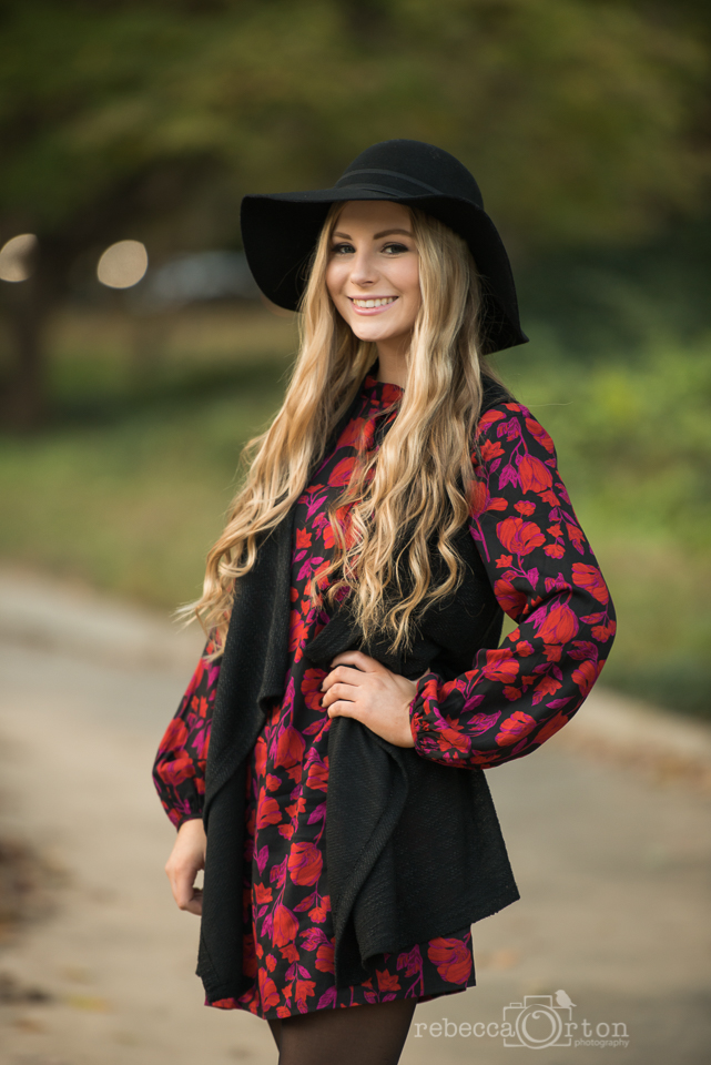 senior girl in black hat