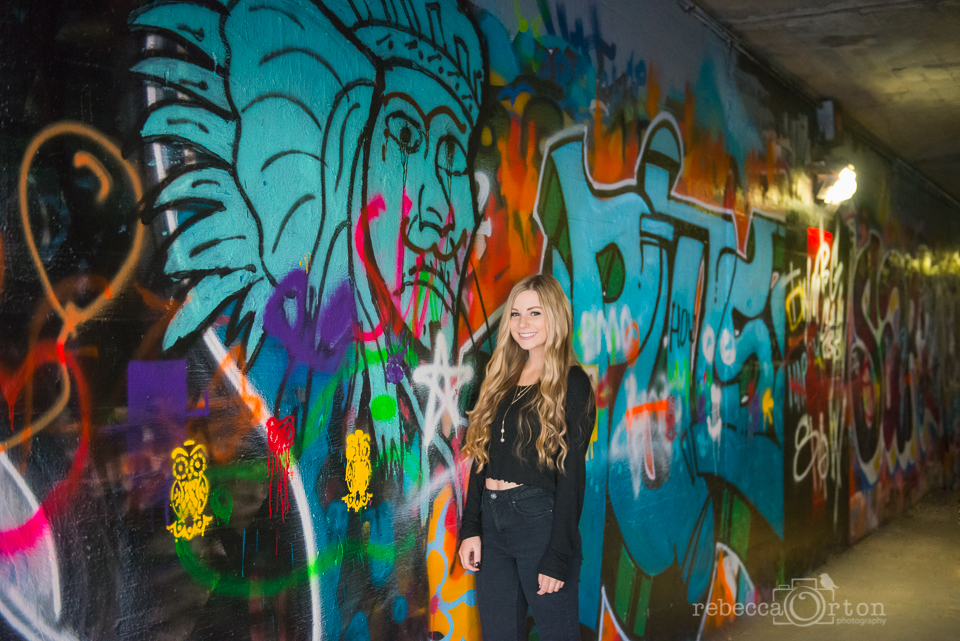 fun senior girl with graffiti