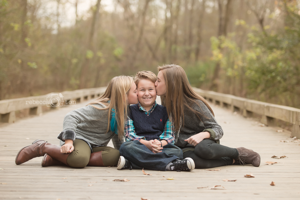 adorable siblings girls kissing brother