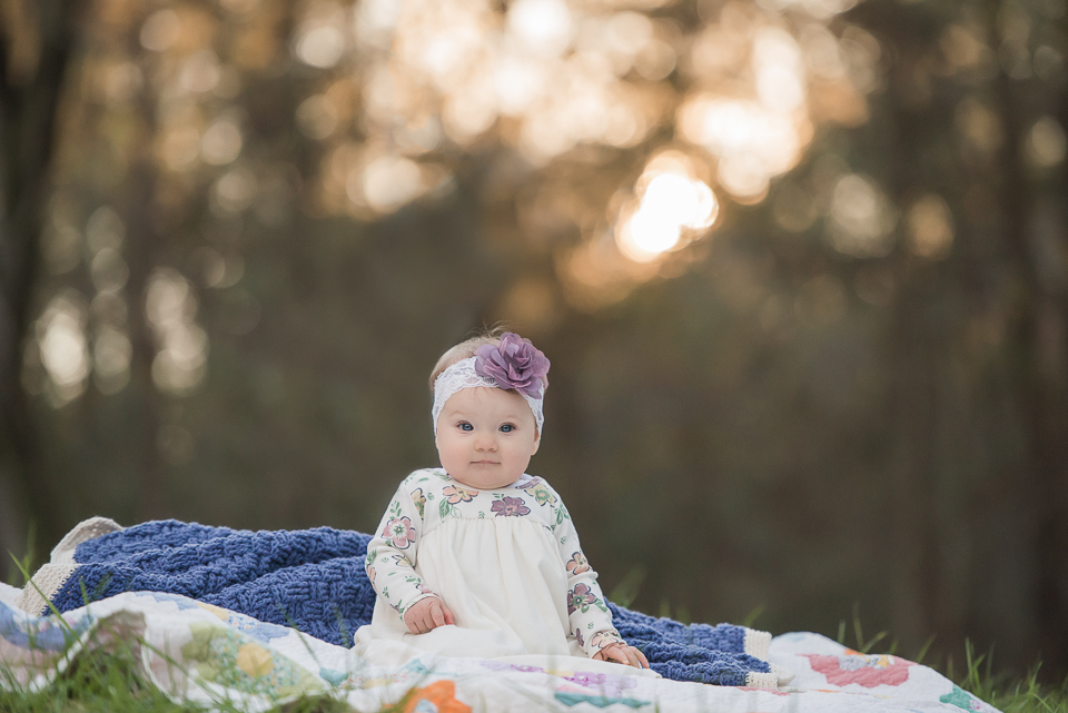 baby girl in headband beautiful light