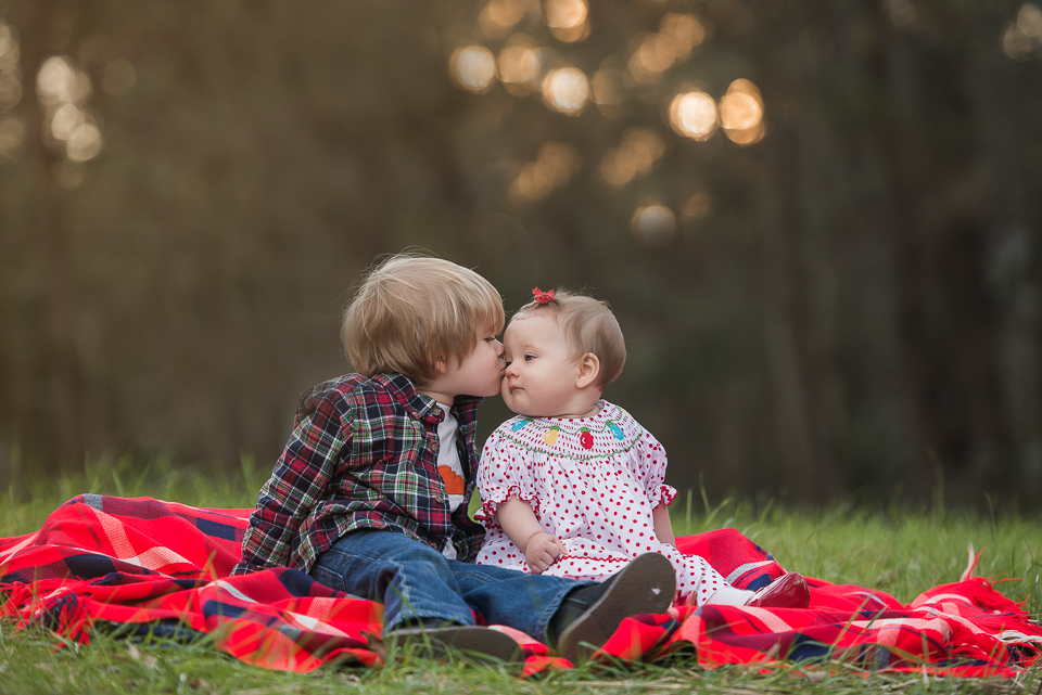 baby sister getting kiss from big brother