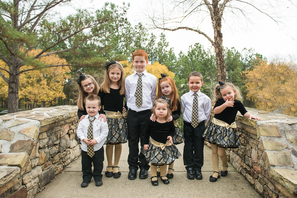 grandchildren cousins in black and gold