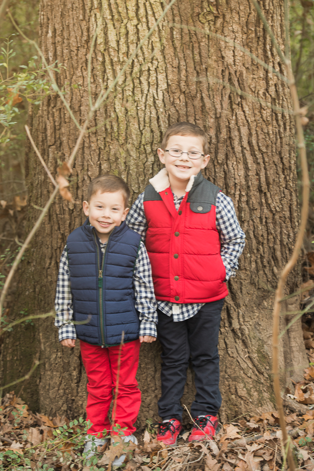 cute brothers by tree