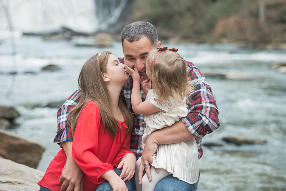 daughters kissing dad waterfall