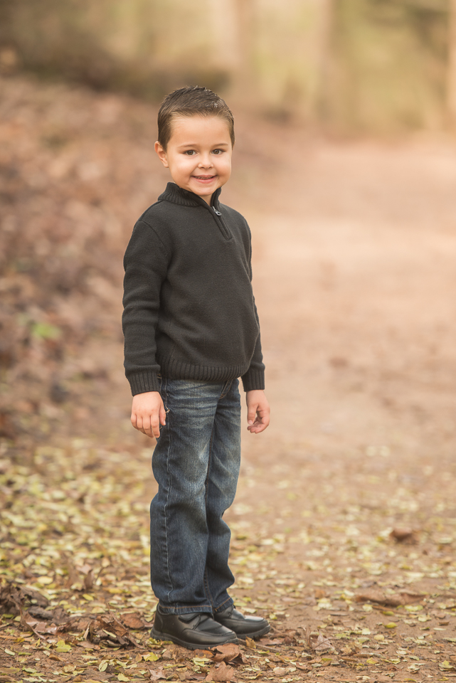 handsome 4 year old boy in black
