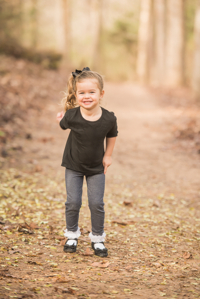 beautiful 3 year old girl with pony tail in black
