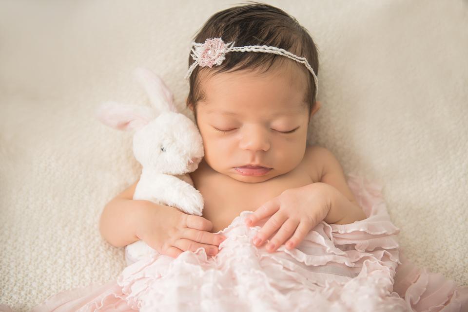 newborn snuggling bunny