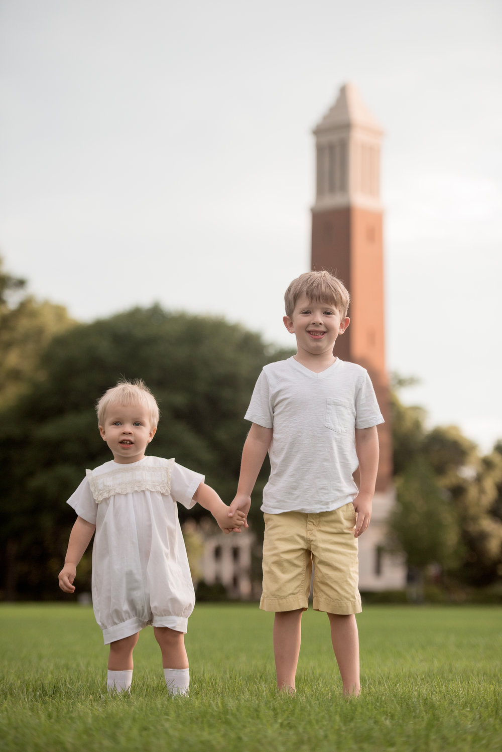 brothers in front of denny chimes