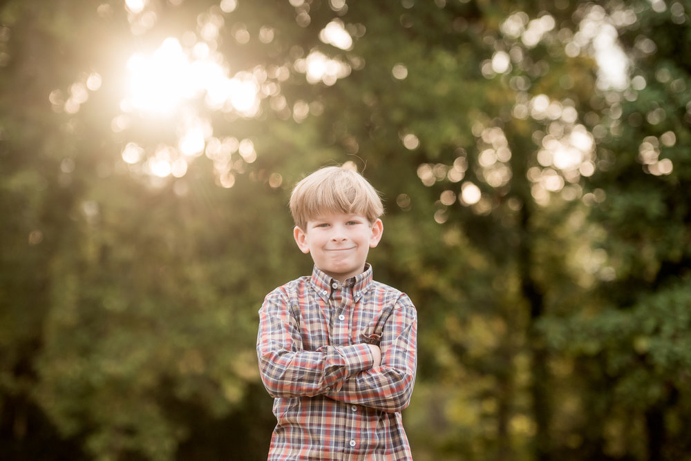 boy in plaid backlit