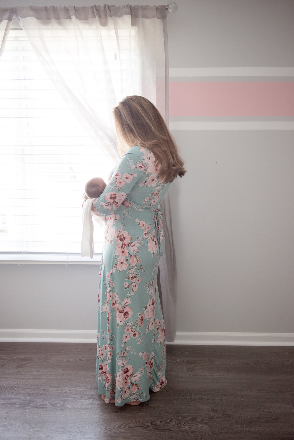 newborn girl and mom in floral maxi dress