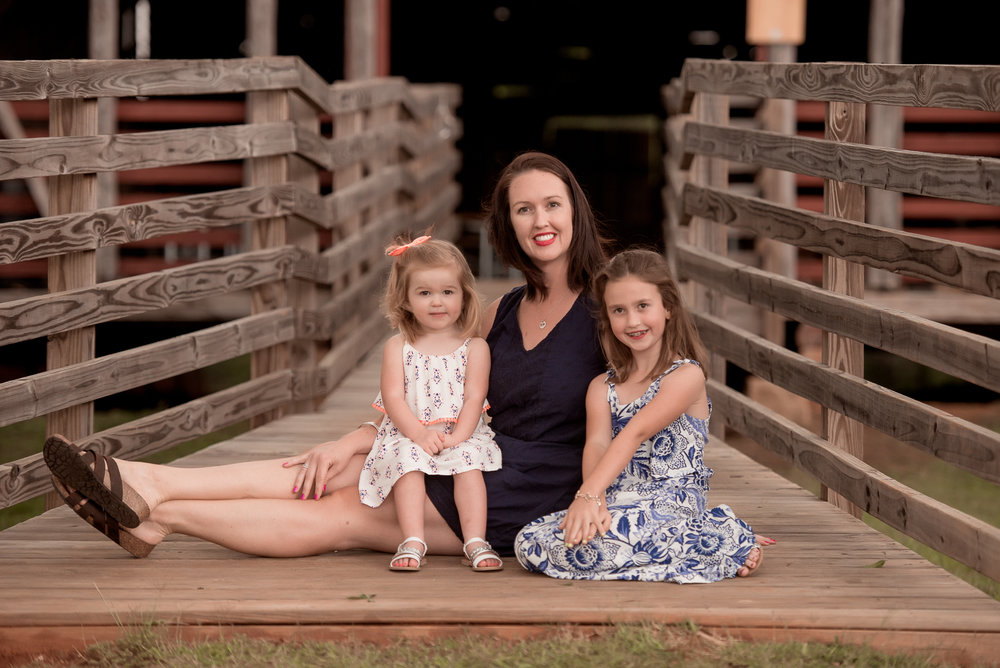 mom and daughters at barn