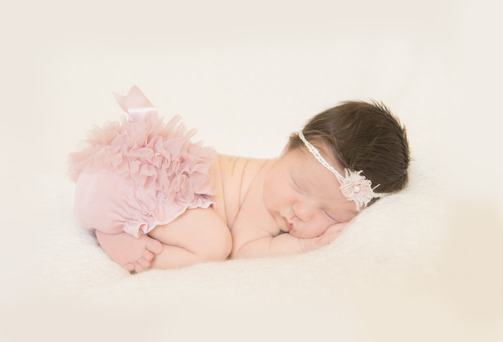 newborn girl in ruffle bloomers