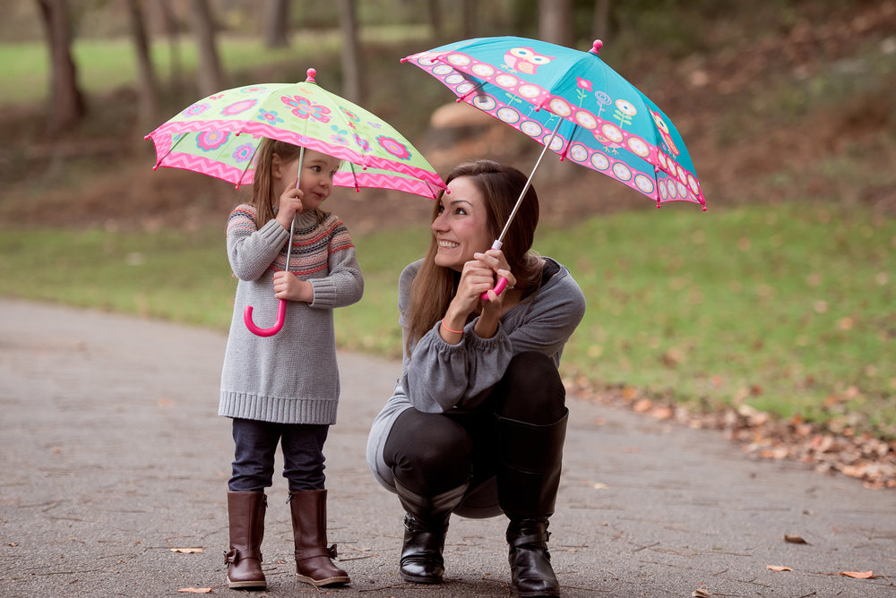mom and daughter with umbrellas
