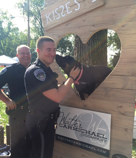 Walter at his Kissing Booth giving a smooch to Parkville's finest!