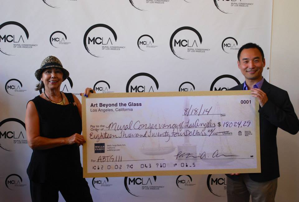 ABTG Co-Founder    Daniel Djang    presents the ABTG III donation check to Mural Conservancy Executive Director    Isabel Rojas-Williams    | Photo courtesy of Mural Conservancy