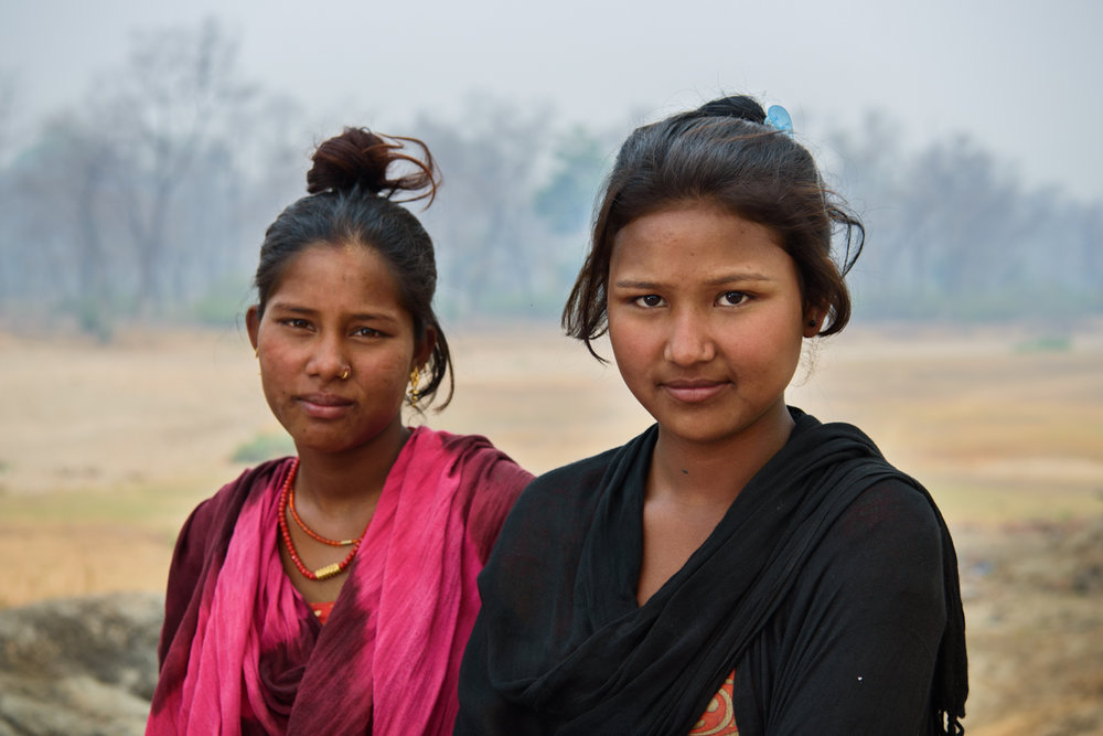 Sharmila Gaine (14) and Sharda Das(15) at Majhi Shivir, Chaumala, Kailali, Nepal. Sharda studies in school and dosent want to get married early like the other girls of her community. Sharmila eloped and married at 12 and is seven months pregnant. Sharmila regrets getting married early and dosent want to have a child.