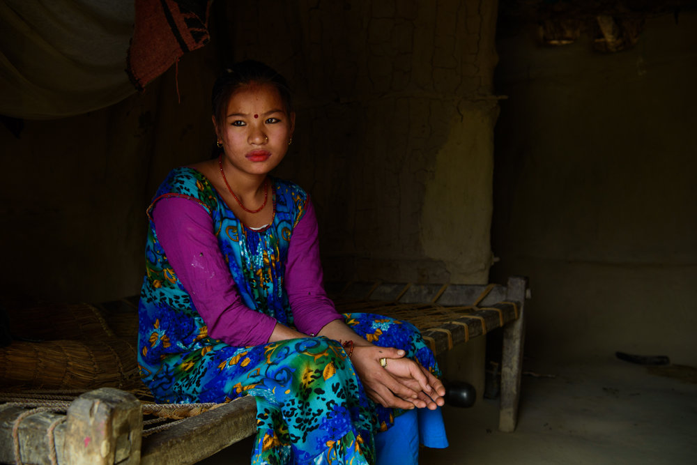 Ganga Maskimagar (17) at her home in Majhi Shivir, Chaumala, Kailali, Nepal. Ganga had an arranged marriage and is five months pregnant. Her husband works as a cook in a restaurant in Delhi.