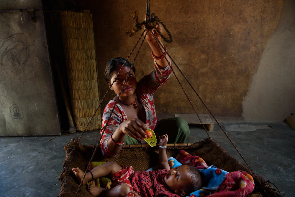 Sarita Majhi (17) with her five months old daughter Sumita at her home in Malpur Village, Chitwan, Nepal. Sarita says she was not interested in studies and left education after class 7. She eloped and married Shiva (20) who works as a labourer in Delhi.