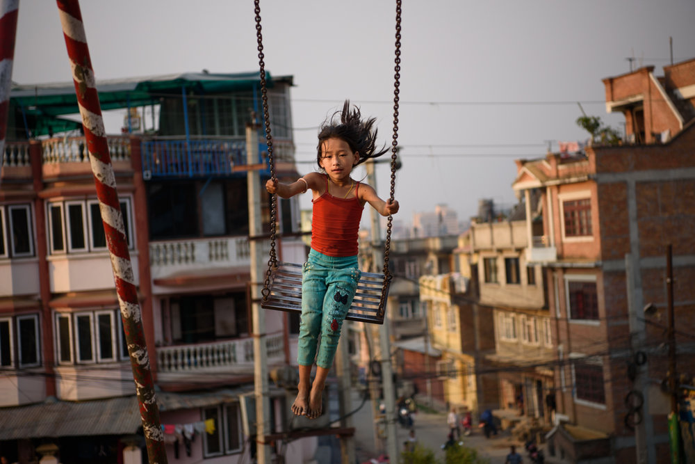 A girl plays at a public park in Patan city, Nepal.