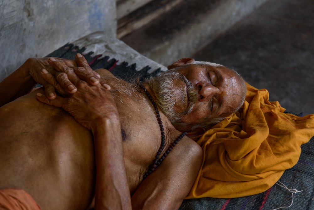 A sadhu takes an afternoon siesta at the men's accomodation section of Mumukshu Bhawan in Varanasi.