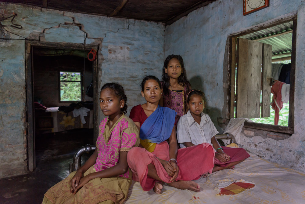 Champa Soren, 35, with her daughters Renuka, 15, Sonika, 16 and Roshni, 10. Champa used to be severely beaten by her abusive husband. To escape that, Champa fell into the hands of a trafficker who promised her a job and took her to Delhi and sold her for $300 in 2014. Champa was rescued from a private residence in Sonipat in July 2017.