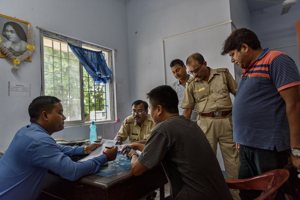 A meeting between a local activist working on anti-human trafficking and police officers at the Banarhat Police Station, West Bengal, India.