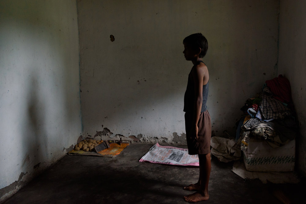 Dinesh , 12, at his home near Binnaguri in West Bengal. Dinesh's mother Pratima has been missing since two years. The family suspects an agent of selling her to a brothel in Delhi.