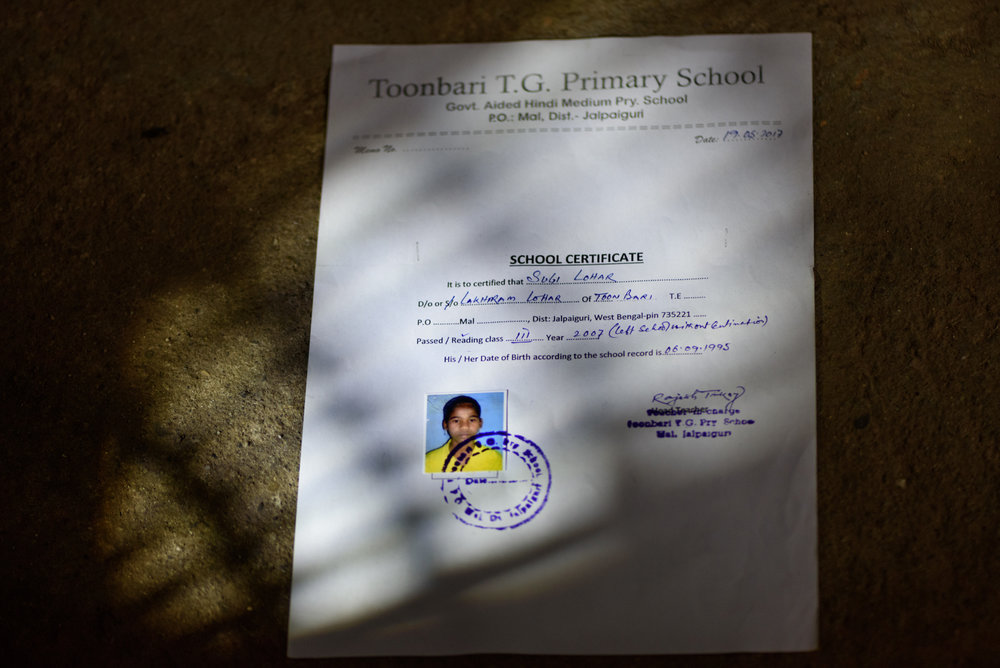 School certificate of Sugi Lohar, 15, who has been missing from the Toonbari Tea Estate since 2007. The certificate was issued earlier this year after Sugi's father requested the school since he required a proof to file a police report. The report was filed in 2017, ten years after her disappearance.
