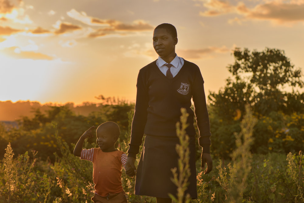 S.B., 20, studies at a girls school. When S. was in class 8, she needed money to register for the final examination and her family could not raise KES 1200. There was a trainee teacher in her school, who said he would give her the money if she had sex with him. After S. got pregnant her teacher ran away . She continued school during her pregnancy and later gave birth to her son S.H..