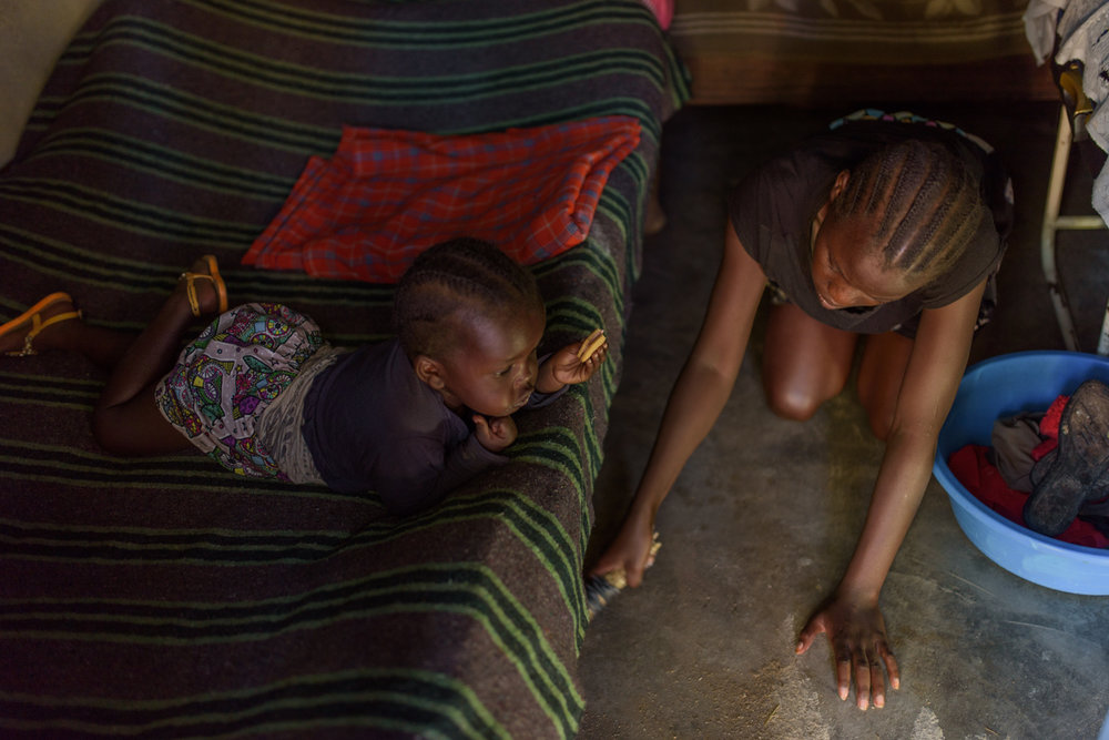 T.R., 17, with her three year old daughter G. at her home in Migori County. T. met a boy three years ago and ended up getting pregnant. She discovered her pregnancy when she was giving Primary School Examination. Her boyfriend deserted her but her grandmother supported her and took her to the hospital for delivery.