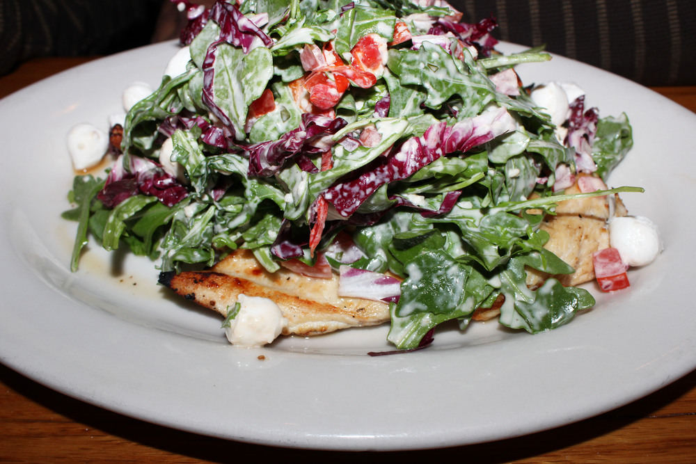 Grilled Chicken Paillard   mozzarella, arugula, fire roasted red pepper,   marinated tomato, Parmesan dressing